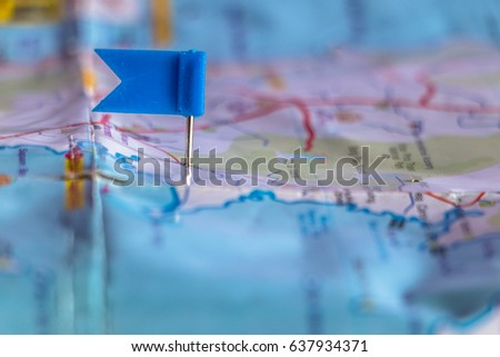 Travel destination pin points on a map with colorful thumbtacks and depth of field with select focus. #637934371