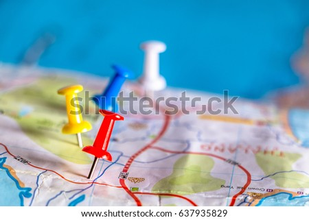 Travel destination pin points on a map with colorful thumbtacks and depth of field with select focus. #637935829