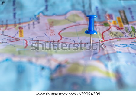Travel destination pin points on a map with colorful thumbtacks and depth of field with select focus. #639094309