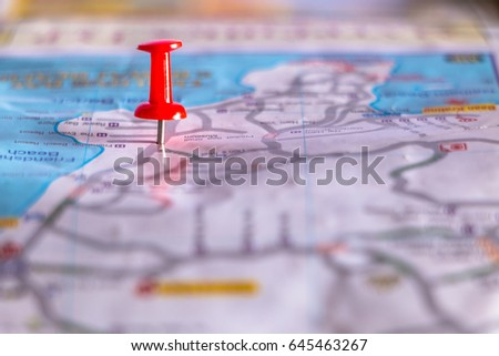 Travel destination pin points on a map with colorful thumbtacks and depth of field with select focus. #645463267
