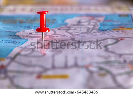 Travel destination pin points on a map with colorful thumbtacks and depth of field with select focus. #645463486