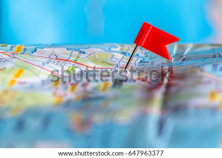 Travel destination pin points on a map with colorful thumbtacks and depth of field with select focus. #647963377