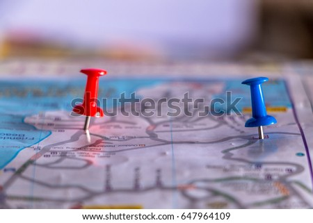 Travel destination pin points on a map with colorful thumbtacks and depth of field with select focus. #647964109