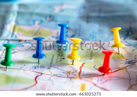 Travel destination pin points on a map with colorful thumbtacks and depth of field with select focus. #663025273