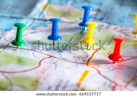 Travel destination pin points on a map with colorful thumbtacks and depth of field with select focus. #664519717