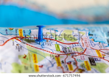 Travel destination pin points on a map with colorful thumbtacks and depth of field with select focus. #671757496
