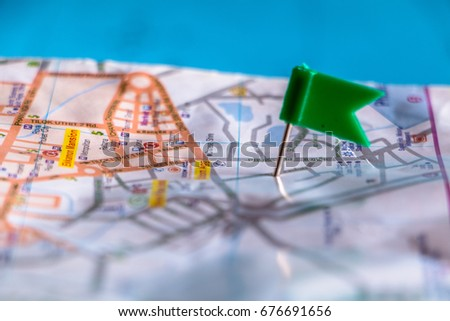 Travel destination pin points on a map with colorful thumbtacks and depth of field with select focus. #676691656
