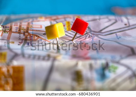 Travel destination pin points on a map with colorful thumbtacks and depth of field with select focus. #680436901