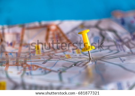 Travel destination pin points on a map with colorful thumbtacks and depth of field with select focus. #681877321