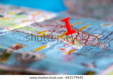 Travel destination pin points on a map with colorful thumbtacks and depth of field with select focus. #683579845