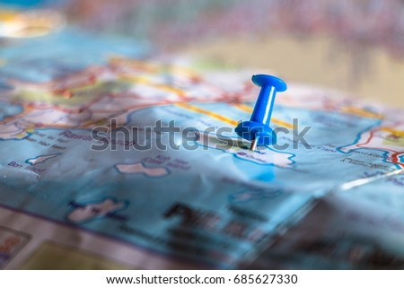Travel destination pin points on a map with colorful thumbtacks and depth of field with select focus. #685627330