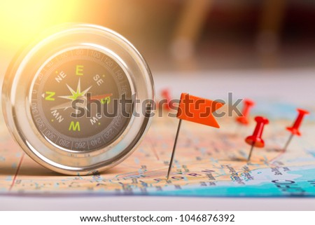 travel destination points and compass on a map #1046876392