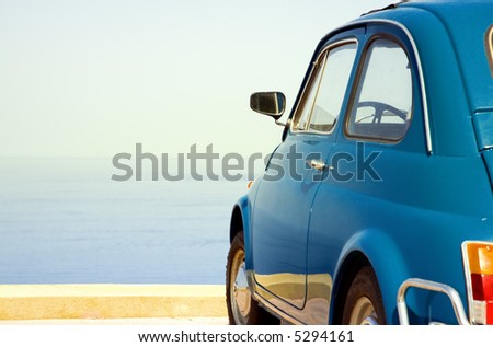 travel destination: vintage car parked near the sea