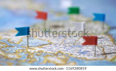Travel destinations in Canada marked with pins on world map, tourism, closeup #1169280859