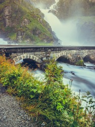 Travel, holidays. Norwegian nature landscape. Famous twin waterfall Latefoss or Latefossen, Odda Hordaland County in Norway.