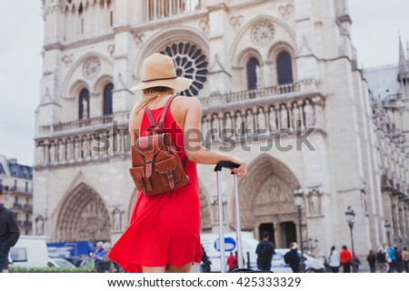 travel in Europe, gothic architecture of catholic church, tourist looking at Notre Dame cathedral in Paris, France