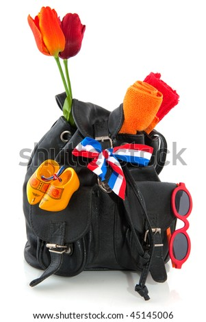 Travel in Holland with backpack flag and souvenirs