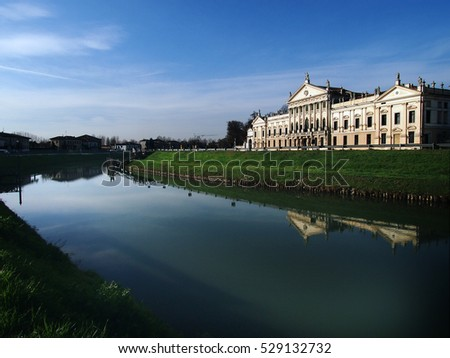 Travel in Italy - Nice view of Villa Pisani and the Brenta River, a famous venetian villas on the Riviera del Brenta, unesco world heritage and italian national museum, in Stra,  Veneto, Italy