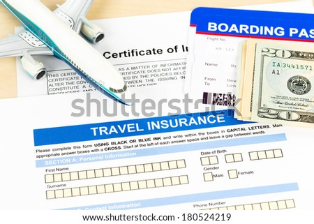 Travel insurance application form with plane model and boarding pass