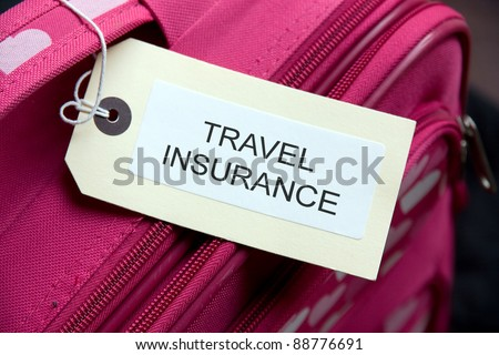 Travel Insurance label tied to a suitcase