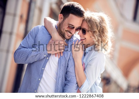 Travel,love,date and people concept-happy couple hugging and smiling in the street. #1222867408
