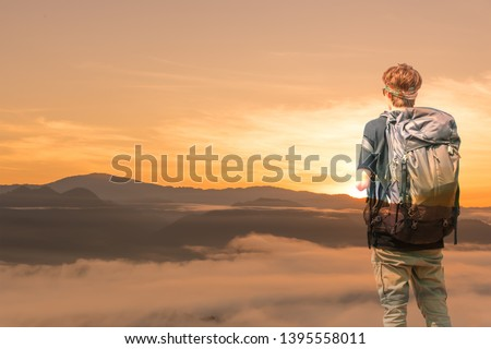 Travel man standing on mountain and  taking picture by digital camera. #1395558011