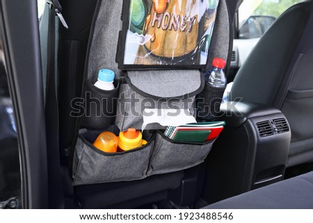 Travel organizer with different things on car seat in salon Сток-фото ©