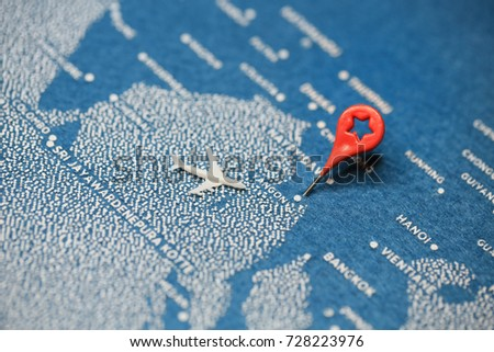 Shutterstock travel painted map with the plane