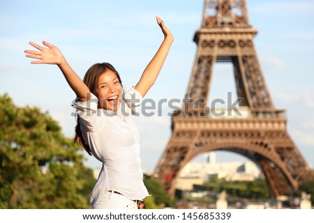 Travel Paris Eiffel Tower woman Happy tourist on travel holidays cheering joyful with arms raised up excited Beautiful multiracial Asian Caucasian woman traveler in tourism concept