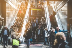 Travel people on escalator at train station - travel concept blur