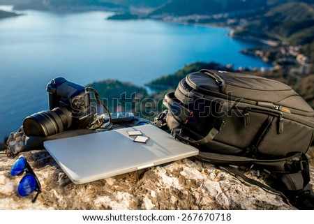 Travel photographer equipment on rocky mountain with beautiful landscape on the background #267670718