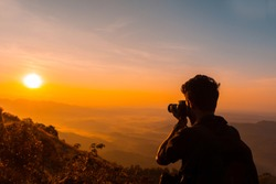 Travel Photographer taking photos of mountains scenery during the sunrise,beautiful Nature landscape scenery shot from Palakkayam Thattu Kannur, Kerala Travel and Tourism Concept Image, indian tourism