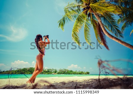 Travel photographer woman takes photos nature landscape on professional dslr camera outdoor #1115998349