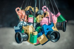 Travel photography cameras for kids and hobbyists made out of colorful plastic, imitating a real 35mm SLR bodies and lenses. Most appreciated by lomo & holga photography enthusiasts.