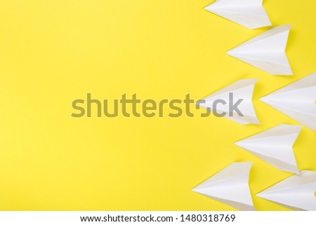 Travel plane concept.Mockup design of travel concept with group airplane on Yellow color background with space for copy space