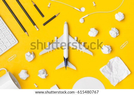 Travel Planning. Airplane, pencil, paper note, paper cilp, earphone, calculator with blank space. Preparation for Traveling and Flat lay Concept. #615480767