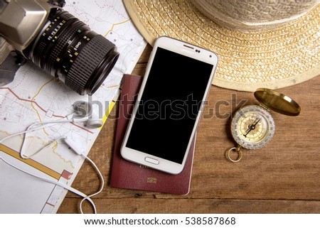 Travel planning with map, smartphone, passport, camera, compass, earphone and straw hat #538587868