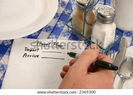 travel plans on a napkin