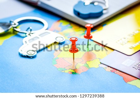 Travel preparation and booking with credit cards on map #1297239388