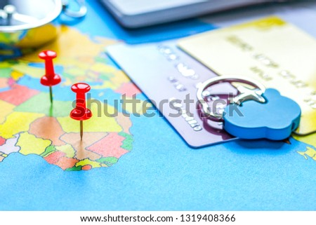 Travel preparation and booking with credit cards on map #1319408366