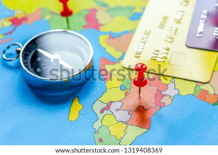Travel preparation and booking with credit cards on map #1319408369