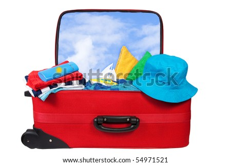 Travel red suitcase. Packed for vacation in sea resort. Personal belongings: hat, cream, towel. Isolated on white