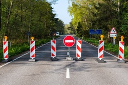 Travel restrictions, borders closure, borders closed during Covid or Coronavirus lockdown, stop sign on the road