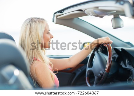 travel, road trip and people concept - happy young woman driving convertible car #722604067