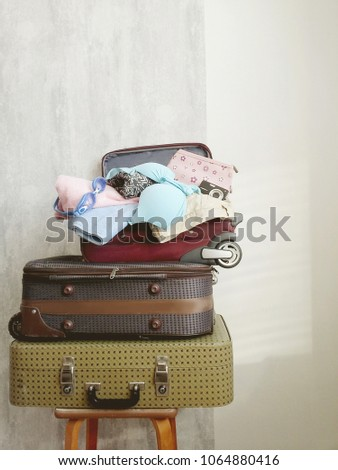 Travel suitcase prepareing concept, preparation for vacation, travel or vacation. #1064880416