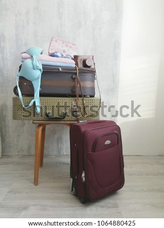 Travel suitcase prepareing concept, preparation for vacation, travel or vacation. #1064880425