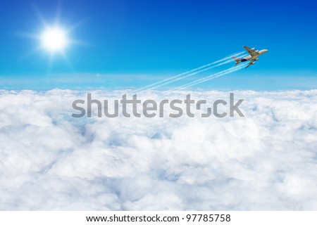 Travel the world concept plane over the clouds - stock photo