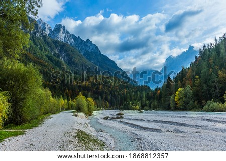 Travel to fabulous Slovenia, Julian Alps. Great Pysnitsa Stream. The shores of Lake Jasne. The famous Triglav Park. The mountains are overgrown with dense mixed forest Zdjęcia stock ©