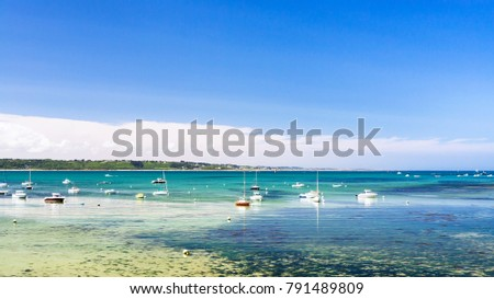 Shutterstock travel to France - bay Anse de Perros of English Channel near Perros-Guirec commune on Pink Granite Coast of Cotes-d'Armor department in the north of Brittany in sunny summer day