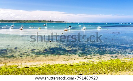 Shutterstock travel to France - boats in bay Anse de Perros of English Channel near Perros-Guirec commune on Pink Granite Coast of Cotes-d'Armor department in the north of Brittany in sunny summer day